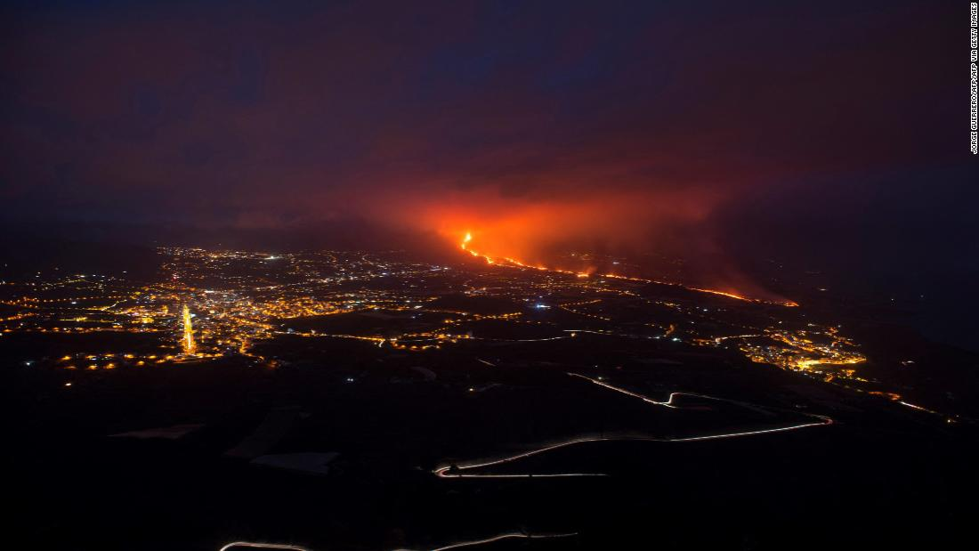 Lava from La Palma volcano sparks cement factory fire, pushing 2,500 people into lockdown